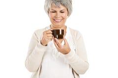 Elderly woman drinking coffee Royalty Free Stock Photo