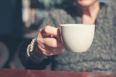 Elderly woman drinking coffee outside Stock Photo