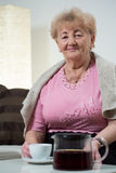Elderly woman drinking coffee Royalty Free Stock Photography