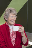 Elderly Woman Drinking Coffee. Royalty Free Stock Images