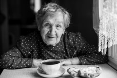 Elderly woman drinking tea. Royalty Free Stock Photo