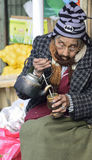 Elderly woman drinking yerba mate Royalty Free Stock Photos
