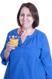 Elderly woman drinks orange juice Royalty Free Stock Photography