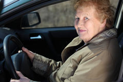 Elderly woman-driver. In car Royalty Free Stock Image