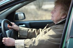 Elderly woman-driver in car Royalty Free Stock Photography