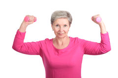Elderly woman with dumbbells Royalty Free Stock Images
