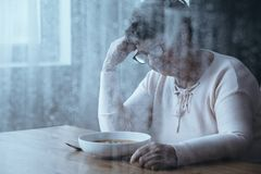 Elderly woman with eating disorders Royalty Free Stock Photos
