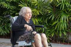 Elderly woman. Elderly eighty plus year old handicap woman in a outdoor setting Royalty Free Stock Images