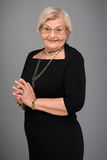 Elderly woman in elegant clothes Stock Images