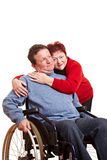 Elderly woman embracing disabled Stock Image