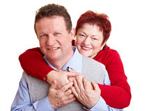 Elderly woman embracing her husband Royalty Free Stock Photo