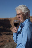 Elderly Woman Enjoying a Glass of Wine Royalty Free Stock Photography