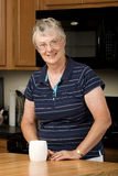 Elderly woman enjoying her morning coffee Stock Photo