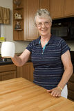 Elderly woman enjoying her morning coffee Royalty Free Stock Photo