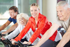 Elderly woman exercising in fitness center Royalty Free Stock Images