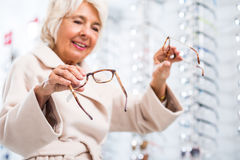 Elderly woman with eyesight problem Stock Photography