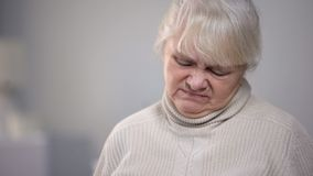 Elderly woman face close-up with disgusting expression, dementia health problem. Stock photo royalty free stock photography