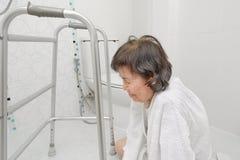 Elderly woman falling in bathroom Stock Photos