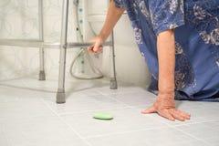 Elderly woman falling in bathroom Royalty Free Stock Image