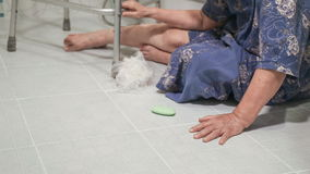 Elderly woman falling in bathroom. Because slippery surfaces stock footage