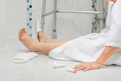 Elderly woman falling in bathroom Royalty Free Stock Images