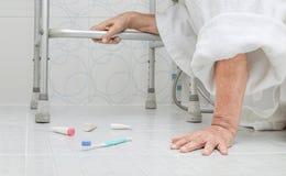Elderly woman falling in bathroom Royalty Free Stock Photos