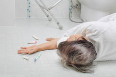 Elderly woman falling in bathroom. Because slippery surfaces Royalty Free Stock Photos