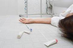 Elderly woman falling in bathroom Stock Photo