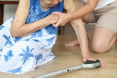 Elderly woman falling down at home ,hearth attack. Elderly women falling down at home daughter support ,hearth attack stock photography