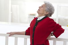Elderly woman feeling unwell with back pain Stock Photos