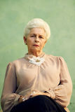 Portrait of serious old caucasian woman looking at camera stock photos