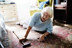 Elderly woman fell on the floor royalty free stock images