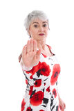 Elderly woman fights back, gestures stop sign. Isolated elderly woman fights back, gestures stop sign royalty free stock photo