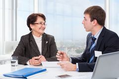 Elderly woman with a financial advisor Royalty Free Stock Images
