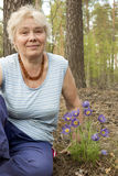 An elderly woman in the forest springtime Stock Photo