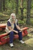 Elderly woman found a mushroom Stock Photo