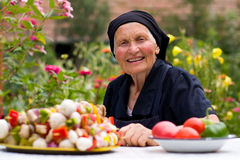Elderly woman with fresh food Royalty Free Stock Photo
