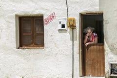 Elderly woman on the front door Stock Photo