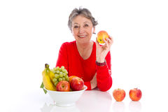 Elderly woman with fruits - elder woman isolated on white backgr Royalty Free Stock Photo