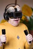 Elderly woman with gaming simulator Royalty Free Stock Photo