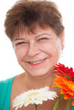Elderly woman with gerberas Stock Image