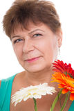 Elderly woman with gerberas Royalty Free Stock Image