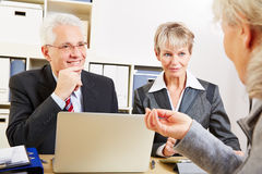 Elderly woman getting financial Stock Images