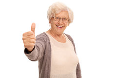 Elderly woman giving a thumb up Stock Image