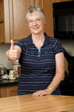 Elderly woman giving thumbs up Royalty Free Stock Photography
