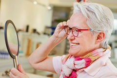Elderly woman with glasses looking Stock Photo