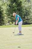 Elderly Woman golfing Stock Image