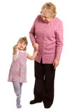 The elderly woman with the grand daughter Stock Photos