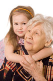 Elderly woman with the grand daughter Stock Photo