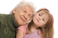 Elderly woman with the grand daughter Royalty Free Stock Image